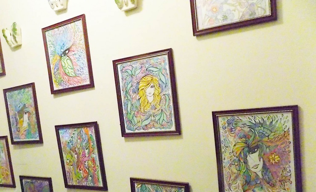 Hallway in Dannie's house showing some of her colorings.
